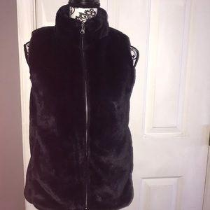 A beautiful NWT J.Crew faux fur vest